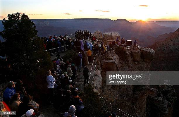 Worshippers and visitors brave a zero degree wind chill to watch the sunrise from Mather Point during an Easter sunrise service at the South Rim of...
