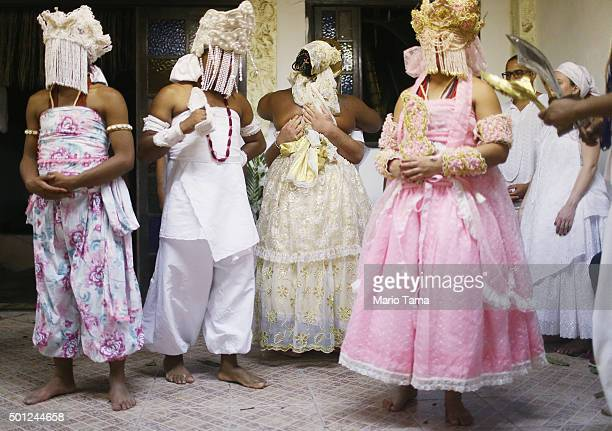 Worshippers are dressed as female deities during a Candomble ceremony honoring goddesses Iemanja and Oxum on December 13 2015 in Itaborai Brazil...