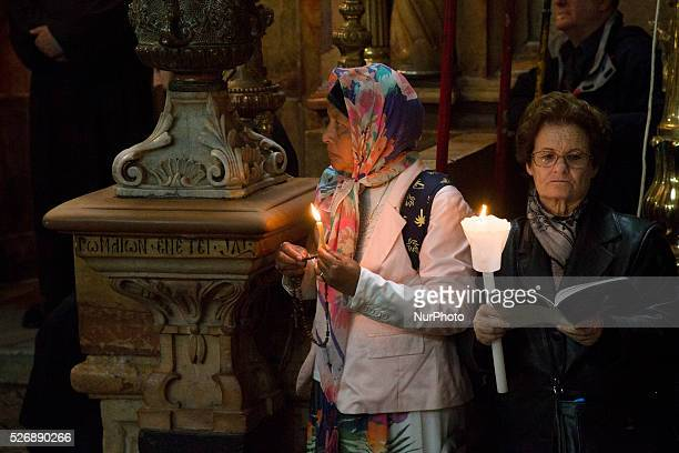 Worshippers are pictured during the Easter Sunday mass in the Church of the Holy Sepulchre in the Old City of Jerusalem Israel on March 27 2016