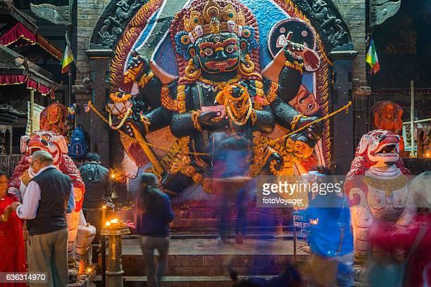 Worshippers at Bhairava Shiva Hindu shrine Durbar Square Kathmandu Nepal