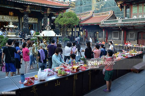 Worshippers at Longshan Temple, Taipei, Taiwan