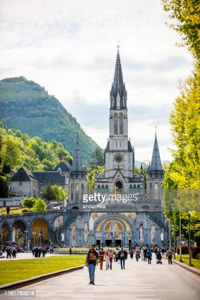 worshippers at the sanctuary of our lady of lourdes, france - our lady of lourdes stock pictures, royalty-free photos & images