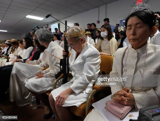 Worshippers at World Peace and Unification Sanctuary hold weapons during their service February 28, 2018 in Newfoundland, Pennsylvania. - Hundreds of...