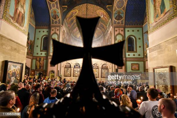 TOPSHOT Worshippers attend a midnight Easter service at the Sioni Cathedral in Tbilisi early on April 28 2019