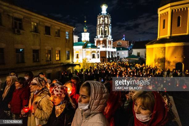 Worshippers attend an Orthodox Easter service in the Vysoko-Petrovsky Monastery in Moscow on May 2, 2021.