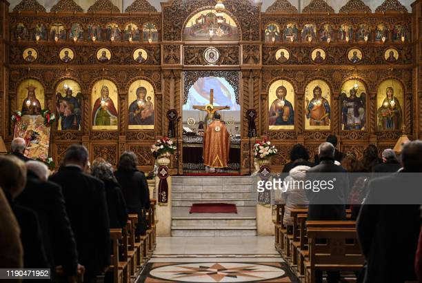 Worshippers attend Christmas Morning mass at the Prophet Elias Greek Orthodox Church in Syria's northern city of Aleppo on December 25 2019