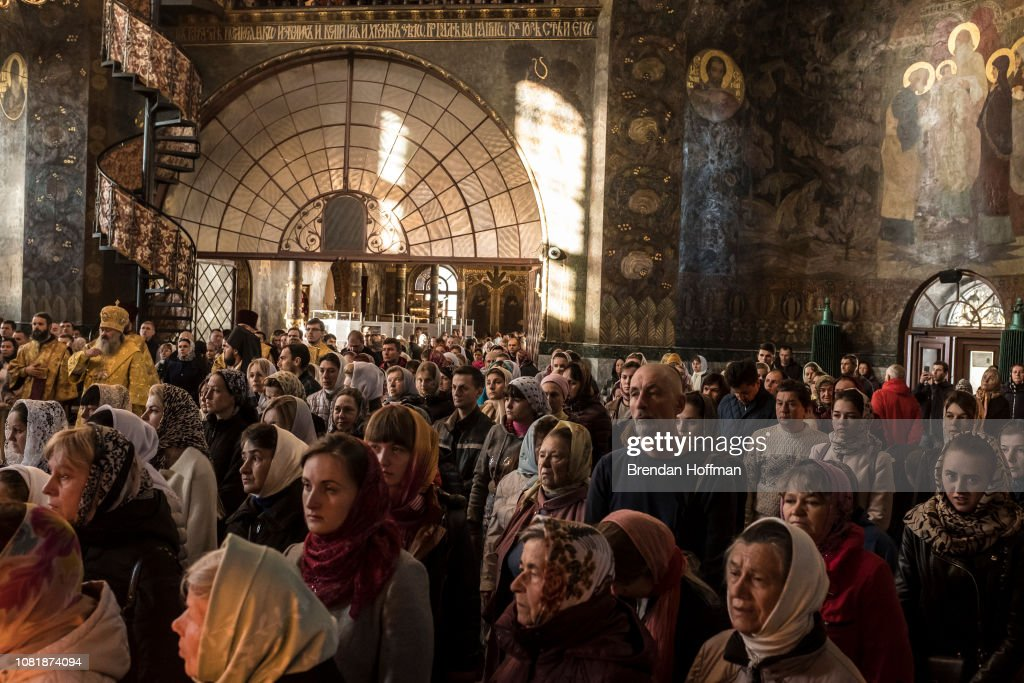 Worshippers attend Sunday Liturgy services at the Refectory