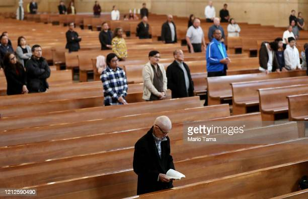Worshippers attend Sunday Mass at the Cathedral of Our Lady of the Angels on March 15, 2020 in Los Angeles, California. Archbishop Jose H. Gomez's...
