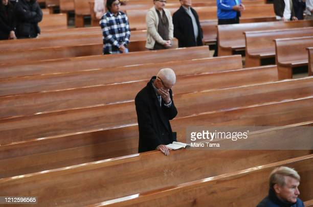 Worshippers attend Sunday Mass at the Cathedral of Our Lady of the Angels on March 15 2020 in Los Angeles California Archbishop Jose H Gomez's...