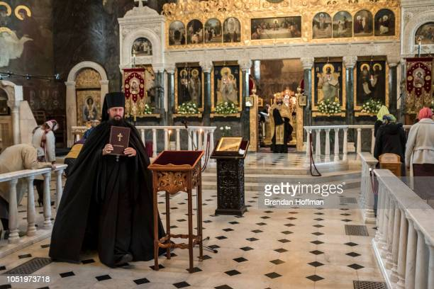 Worshippers attend the Evening Divine Office service at the Refectory Church of Sts Anthony and Theodosius at the KyivPechersk Lavra on October 12...