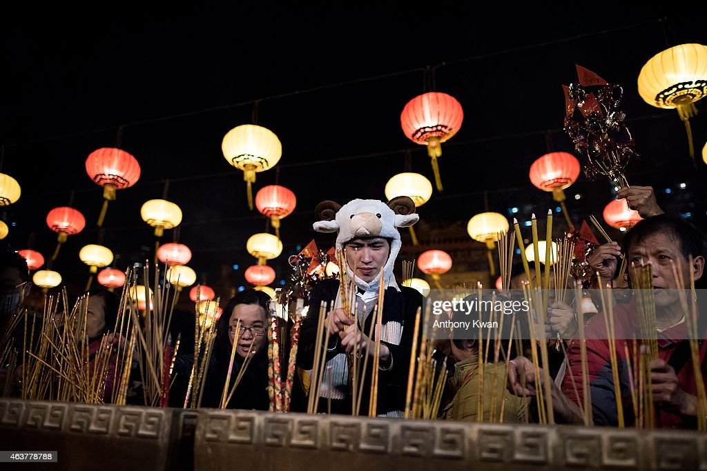 Worshippers burn incense and pray at Wong Tai Sin Temple on the first day of Lunar New Year holiday on February 18, 2015 in Hong Kong. Tens of thousands of worshippers flocked to temples across to pray for good luck and fortune for the Year of Sheep.