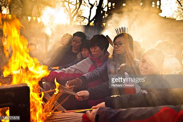 Worshippers burning incense at Lama Temple on Chinese New Year day.