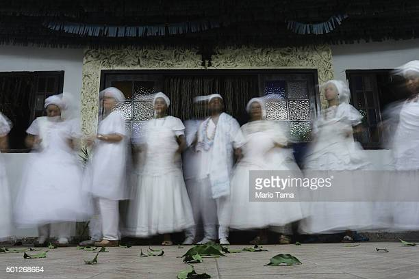 Worshippers dance and are blurred during a long exposure during a Candomble ceremony honoring goddesses Iemanja and Oxum on December 12 2015 in...