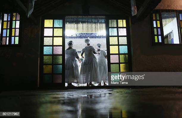 Worshippers dance during a Candomble ceremony honoring goddesses Iemanja and Oxum on December 12 2015 in Itaborai Brazil Candomble is an...