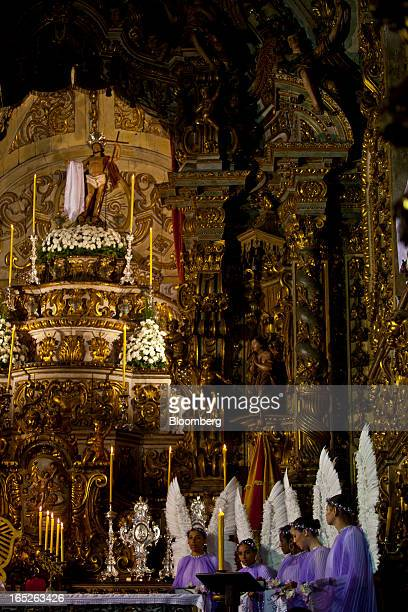 Worshippers dressed as angels celebrate Easter Sunday at a church in Ouro Preto Brazil on Sunday March 31 2013 Brazil is home to the world's largest...