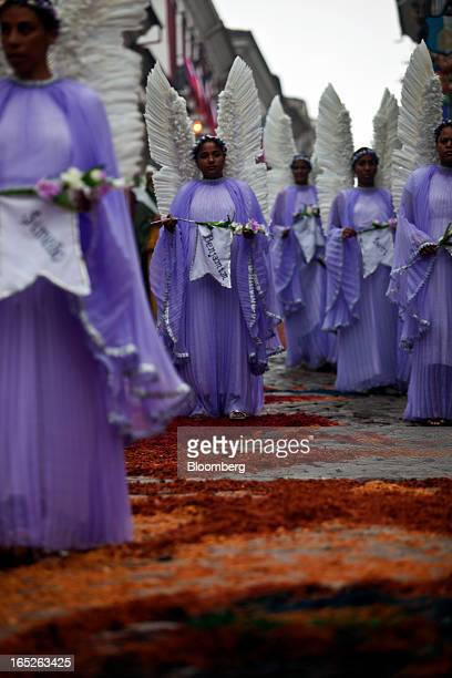 Worshippers dressed as angels celebrate Easter Sunday with a procession in Ouro Preto, Brazil, on Sunday, March 31, 2013. Brazil is home to the...