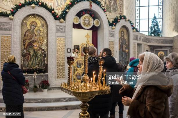 Worshippers during liturgy at the Holy Transfiguration Cathedral which changed its affiliation from the Russian Orthodox Church to the Orthodox...