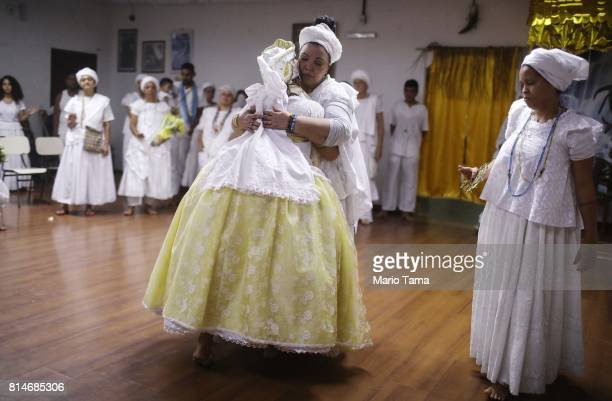 Worshippers embrace during a Candomble ceremony on July 14 2017 in Sao Goncalo Brazil Candomble is an AfroBrazilian religion whose practitioners...