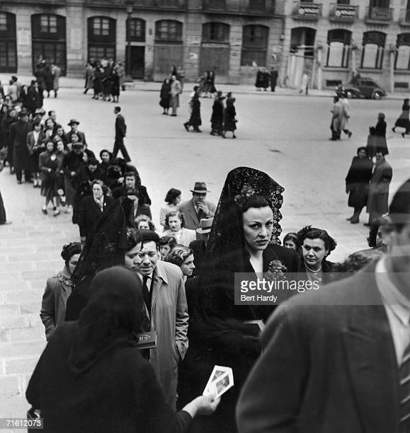 Worshippers filing into Barcelona's great cathedral Santa Eulalia on Good Friday 14th April 1951 Two ladies are wearing the traditional mantilla...
