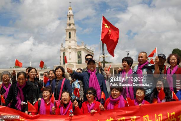 Worshippers from China wave a flags in the air as they pose for pictures at the Sanctuary of Fatima on May 12 2017 in Fatima Portugal Pope Francis...
