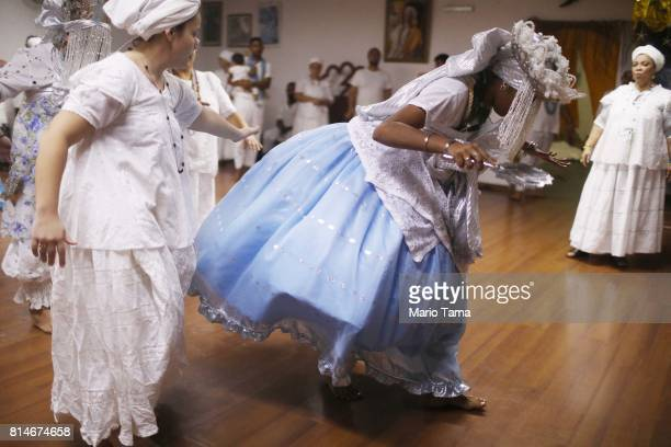 Worshippers gather and dance during a Candomble ceremony on July 14 2017 in Sao Goncalo Brazil Candomble is an AfroBrazilian religion whose...
