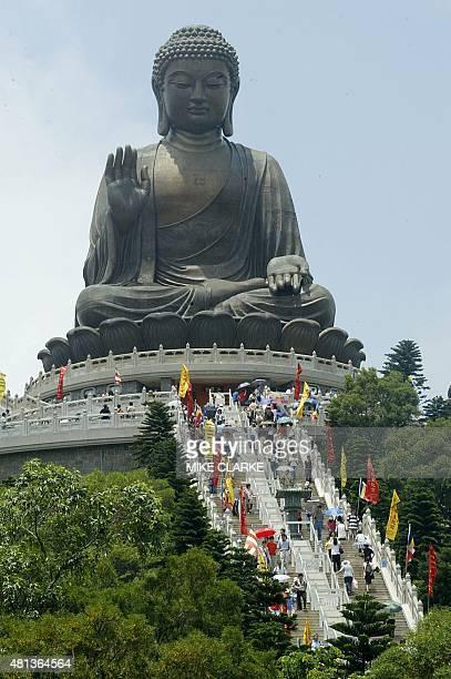 Worshippers gather at the giant Buddha Po Lin Monastery on Lantau Island near Hong Kong 26 May 2004 Today marks Buddha's birthday born in 544 BC one...