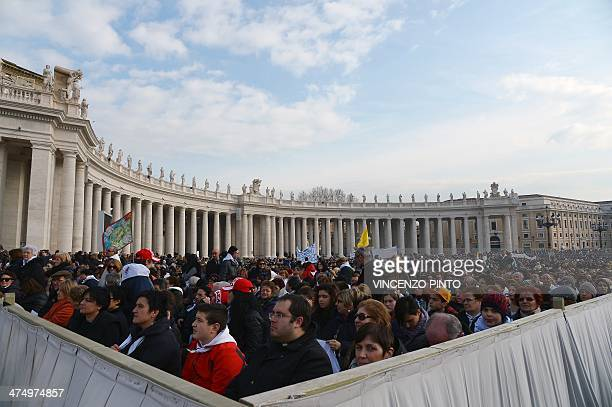 Worshippers gather beside the colonnade in Saint Peter's square at the Vatican during Pope Francis' general audience on February 26 2014 Scaffolding...