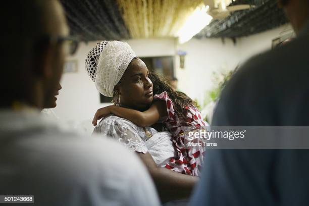 Worshippers gather during a Candomble ceremony honoring goddesses Iemanja and Oxum on December 13 2015 in Itaborai Brazil Candomble is an...