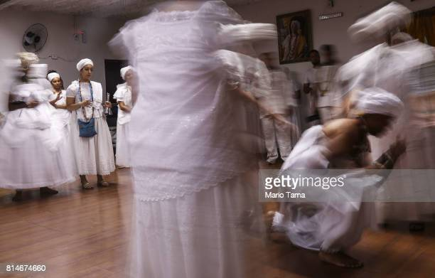 Worshippers gather during a Candomble ceremony on July 14 2017 in Sao Goncalo Brazil Candomble is an AfroBrazilian religion whose practitioners...