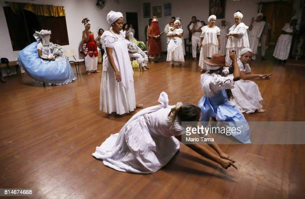 Worshippers gather during a Candomble ceremony on July 14 2017 in Sao Gonzalo Brazil Candomble is an AfroBrazilian religion whose practitioners...