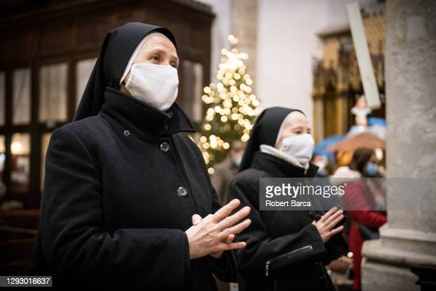 Worshippers gather for a midnight Christmas mass served by Archbishop of the Bratislava archdiocese Stanislav Zvolensky at St. Martin's Cathedral on...