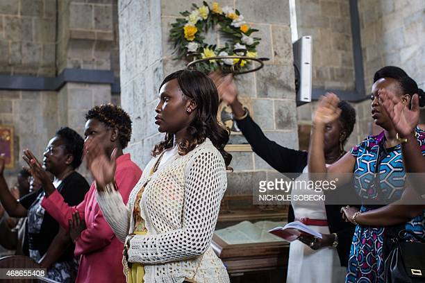 Worshippers gather for an Easter service at the All Saints' Cathedral in Nairobi on April 5 mourning the country's worst ever massacres the killing...