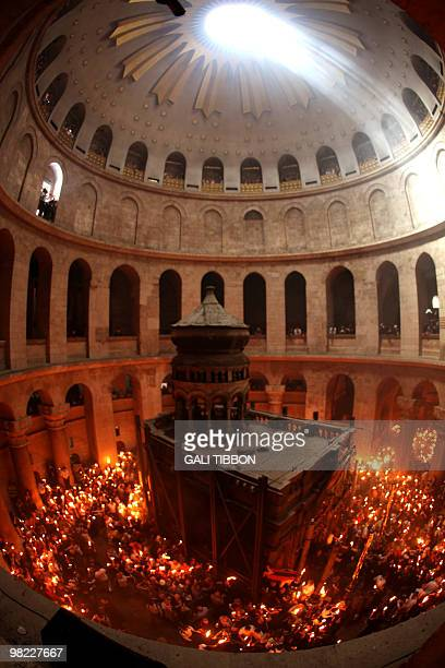 Worshippers gather in the rotunda of the Church of the Holy Sepulchre to light their candles from the 'Holy Fire' on the eve of Easter Sunday as the...