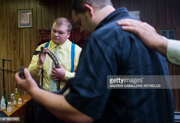 Worshippers handle rattle snakes during a Pentecostal serpent handlers service at the House of the Lord Jesus church in Squire West Virginia on May...
