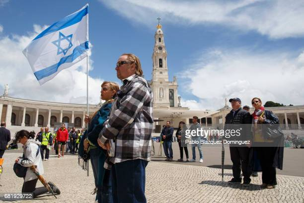 Worshippers holding the Israel flag attend a mass in the Sanctuary of Fatima on May 11 2017 in Fatima Portugal Pope Francis will be attending the...