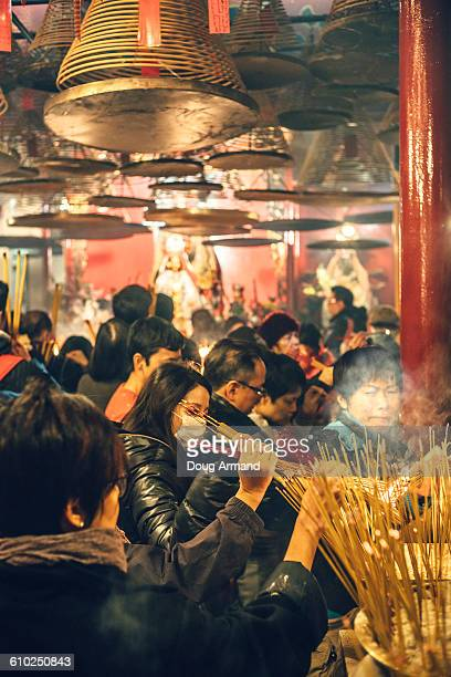 worshippers inside the man mo temple, hong kong - china execution stock pictures, royalty-free photos & images