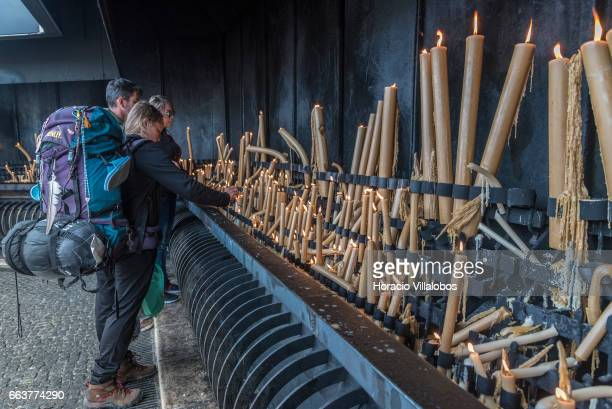Worshippers light candles and pray at the Sanctuary of Fatima on March 31 2017 in Fatima Portugal Thousands of pilgrims and worshippers visit daily...