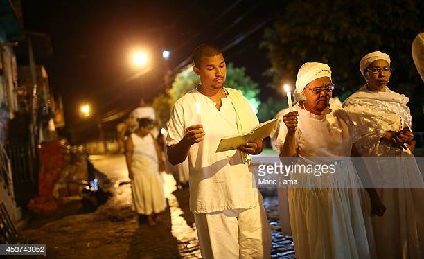 Worshippers march during a Candomble ceremony on August 16 2014 in Cachoeira Brazil Candomble is an AfroBrazilian religion whose practitioners often...