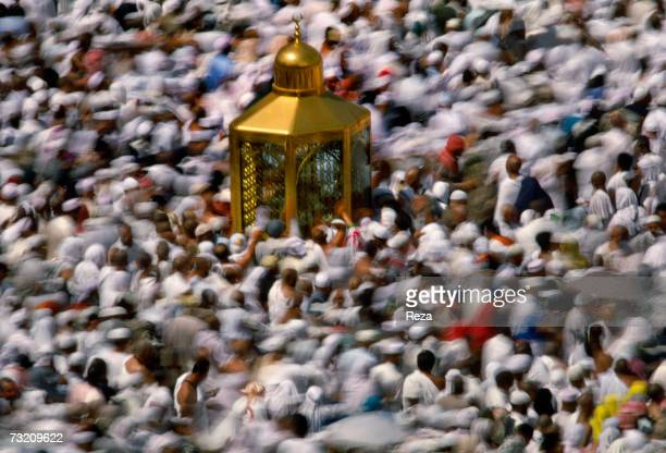 Worshippers move around the small shrine Maqam Ibrahim which legend states holds a stone which retains the permanent footprint of the prophet Abraham...