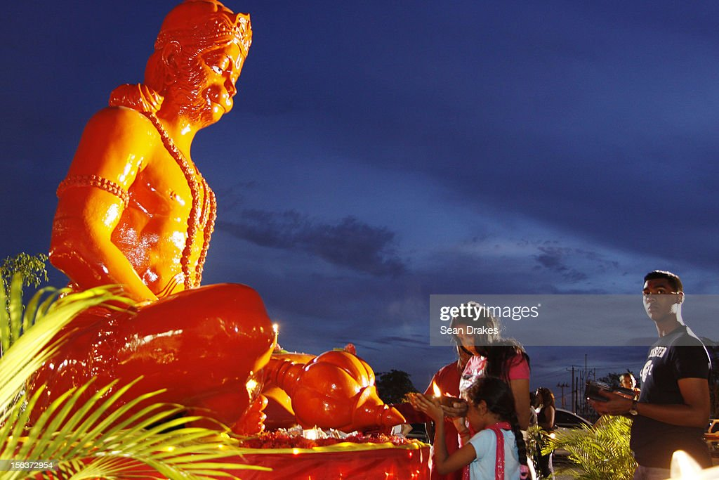 Worshippers perform a ritual during the Divali Festival celebrations at the Divali Nagar on November 12, 2012 in Chaguanas, Trinidad.