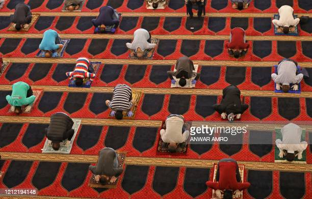 TOPSHOT Worshippers perform the Friday prayers during the Muslim holy month of Ramadan while keeping a safe distance from each other at the Mohammed...