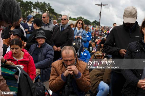 Worshippers pray as they wait for the arrival of Pope Francis at the Sanctuary of Fatima on May 12 2017 in Fatima Portugal Pope Francis will be...