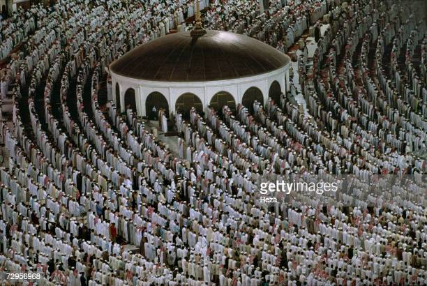 Worshippers pray in the Masjid AlHaram mosque on the morning of EidulFitr day which marks the end of Ramadan on March 2000 in Mecca Saudi Arabia