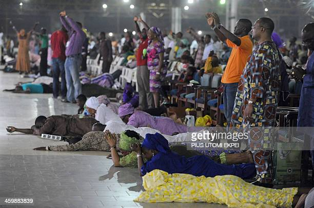 Worshippers pray into the New Year lying down during the crossover watch night church service at the Redemption Camp on Lagos Ibadan highway on...