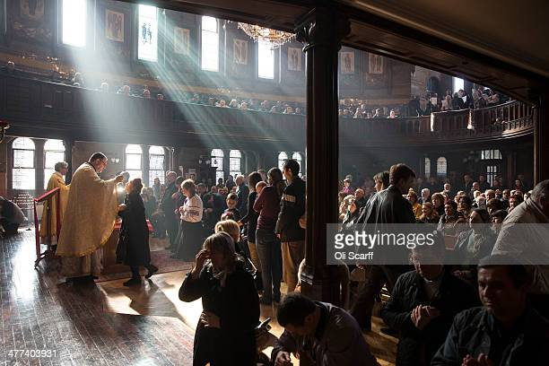 Worshippers receive communion during a mass in The Ukrainian Cathedral of the Holy Family in Exile, part of the Ukrainian Greek Catholic Church, led...
