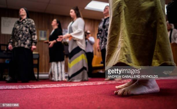 Worshippers sing and dance during a Pentecostal serpent handlers service at the House of the Lord Jesus church in Squire West Virginia on May 27 2018...