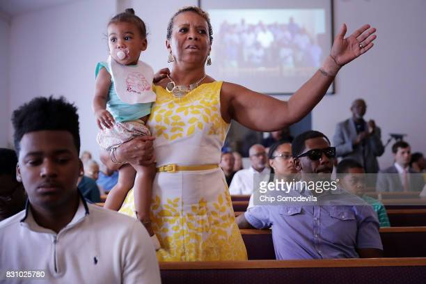 Worshippers sing and pray during a service at Mt Zion First African Baptist Church August 13 2017 in Charlottesville Virginia Virginia Gov Terry...