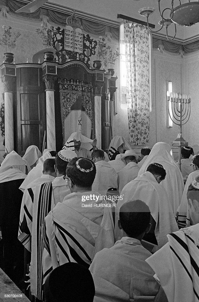 Worshippers take part in a ceremony inside a Yemenite