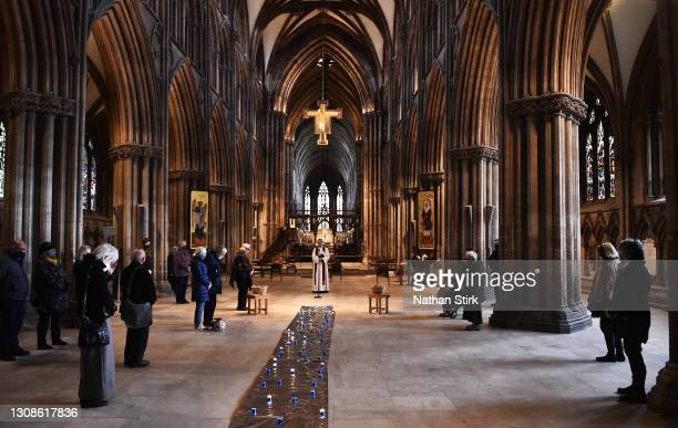 Worshippers take part in a minutes silence during a service of remembrance held at Lichfield Cathedral on March 23, 2021 in Lichfield, England. Marie...