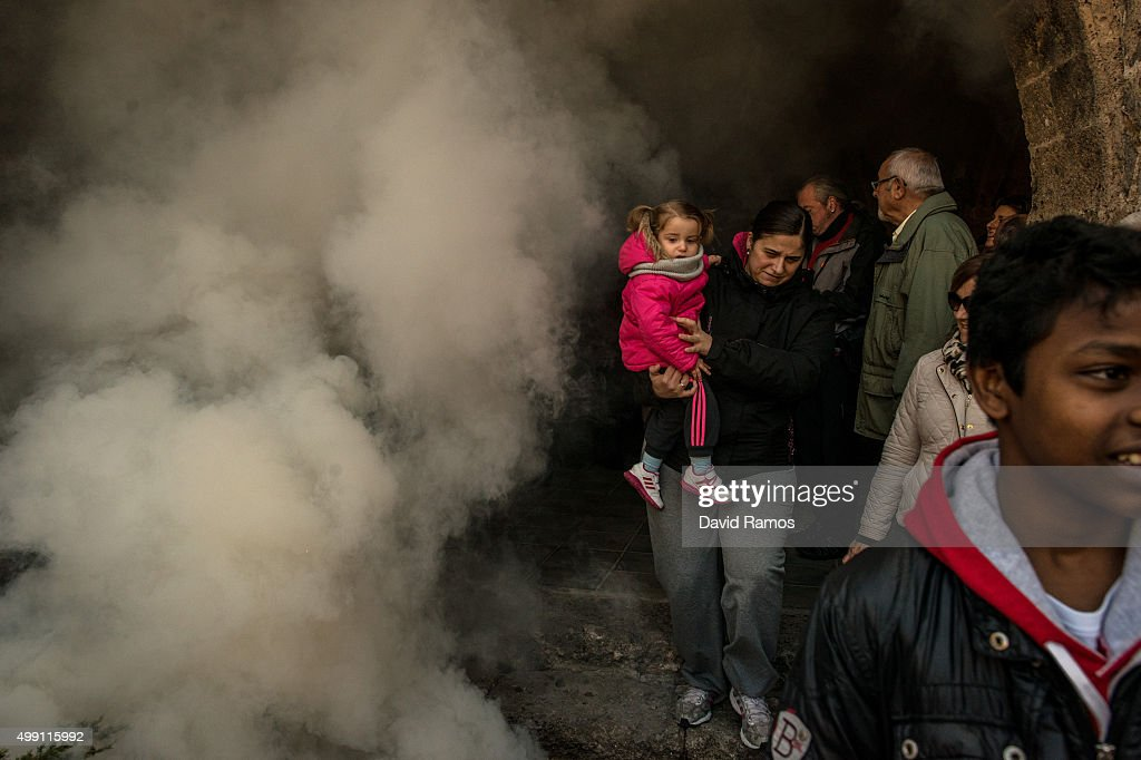 Worshippers take part on the 'Procesion del Humo' (Procession of the Smoke) on November 29, 2015 in Arnedillo, Spain. Villagers of Arnedillo light bonfires of pine and rosemary to honor San Andres every last sunday of November. The roots of this procession are found in 1888 when a outbreak of smallpox devastated the village. The survirvors decided to light a black candle for each of their seven Saints. The candle of San Andres was the last one to go out and villagers decided to name San Andres as Saint Patron of Arnedillo.